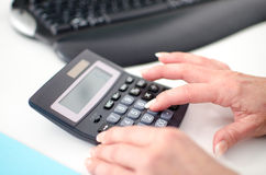 Woman's hand using a calculator Royalty Free Stock Image