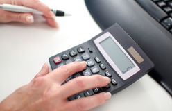 Woman's hand using a calculator Royalty Free Stock Photo