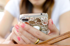 Woman's Hand Using Cell Phone Royalty Free Stock Photos