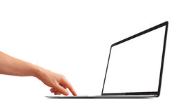 Woman's hand using a laptop with a blank screen stock images