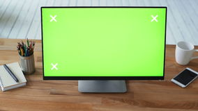 Woman`s hand using pc with green touch screen monitor. On her desk. Isolated concept of advertising for web-content. Workspace with office table and greenscreen stock footage