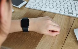 Woman`s hand wearing elegant smartwatch stock photography