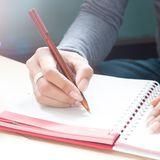 Woman`s Hand Writing On Notebook Diary, Close Up. 2019 New Year Royalty Free Stock Photography