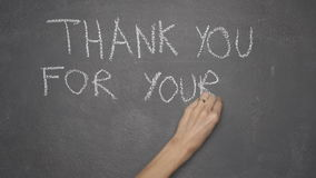 Hand writing `THANK YOU FOR YOUR ATTENTION` on black chalkboard. Woman`s hand writing `THANK YOU FOR YOUR ATTENTION` with white chalk on blackboard stock video footage