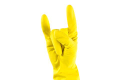 Woman's hand in yellow rubber gloves shows 'Horns Up' sighn Royalty Free Stock Photos