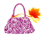 Woman's handbag and red autumn leaves Stock Images