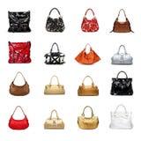 A woman's handbag on a white variety Stock Photo