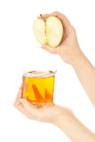 Woman's hands with apple fresh juice Royalty Free Stock Image