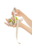 Woman's hands with apple with measuring tape Stock Photos