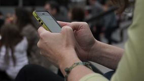 A woman's hands as she uses her smart phone stock video footage