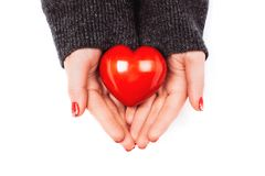 Woman`s hands carefully keep red heart Royalty Free Stock Photography