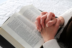 Woman's Hands And the Bible royalty free stock photos