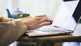 Woman s hands with blue nail polish typing at laptop stock footage