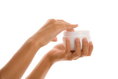 Woman's hands with body lotion Stock Image