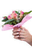 Woman's hands with bouquet of flowers Stock Photography