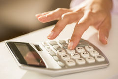 Woman's hands with a calculator, Accounting. Stock Image