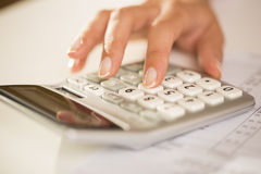 Woman's hands with a calculator, Accounting. Stock Photos