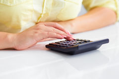 Woman's hands with a calculator stock image