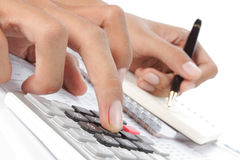 Woman's hands with a calculator and a pen Stock Photos
