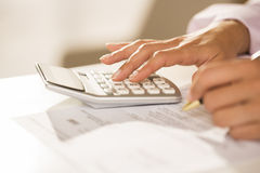 Woman's hands with a calculator and pen, Accounting. Stock Photo