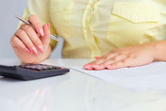 Woman's hands with a calculator Stock Photography