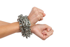 Woman's hands chained together Stock Photo
