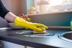 Woman's hands cleaning kitchen cabinets Stock Photos