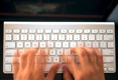 Woman's hands on a computer keyboard Royalty Free Stock Photography