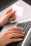 Woman's hands with computer keybord and business c Royalty Free Stock Photos