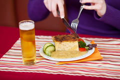 Woman's Hands Cutting Delicious Meal With Fork And Knife At Tabl Royalty Free Stock Photos