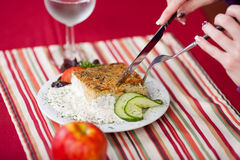 Woman's Hands Cutting Meal With Fork And Knife At Table Royalty Free Stock Photography