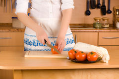 Woman's hands cutting tomato Royalty Free Stock Photo