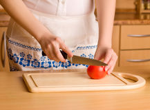 Woman's hands cutting tomato Royalty Free Stock Photography