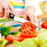 Woman's hands cutting vegetables Stock Image