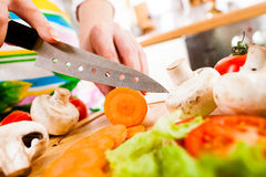 Woman's hands cutting vegetables Royalty Free Stock Photos