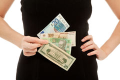 Woman's hands with different banknotes Royalty Free Stock Photo