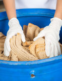Woman's Hands Discarding Bread Waste In Garbage Royalty Free Stock Photography