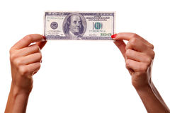 Woman's hands and dollars. Royalty Free Stock Image