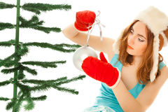 Woman's hands dressing christmas tree Stock Images