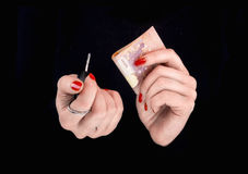 Woman's hands with eurobanknotes and car keys Stock Photos