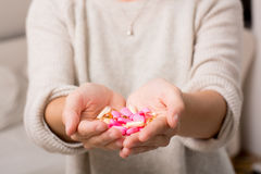 Woman's hands filled with many drugs Stock Images