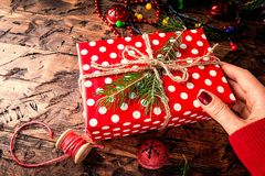 Woman`s hands give christmas gift stock photo