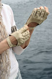 Woman's hands in gloves. Woman in scarf dress beige gloves Royalty Free Stock Photo