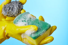 Woman's hands in gloves with sponge Royalty Free Stock Image