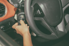 Woman 's hands hold the key for starting the car,selective focus Royalty Free Stock Images