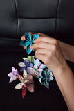 Woman's hands is holding beautiful origami Stock Photos
