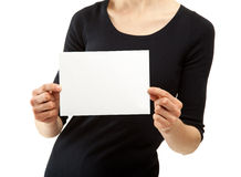 Woman's hands holding blank sheet of paper Royalty Free Stock Photography