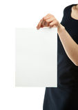 Woman's hands holding blank sheet of paper Stock Photo