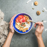 Woman`s hands holding blue healthy breakfast bowl Royalty Free Stock Photography