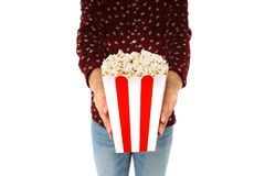 Woman`s hands holding bucket with popcorn. On white background Royalty Free Stock Images